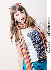 young charming beautiful woman in jeans white t-shirt with scarf glasses on head looking toward
