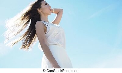 Young charming brunette woman on sea coast. Amazing view...