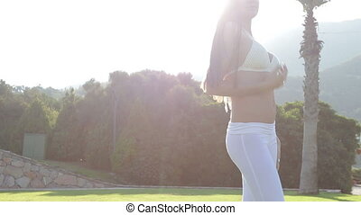 Young charming girl at dawn in white swimsuit - Young...
