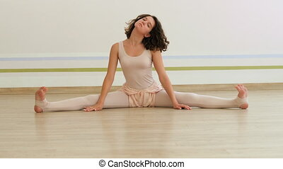 Young charming woman practicing yoga at light minimalist...