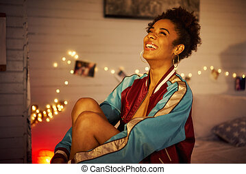 Young Cheerful Black Woman Smiling At Night
