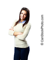 Young cheerful businesswoman standing with arms folded isolated on a white background