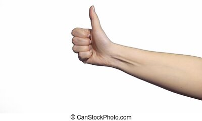 Young cheerful caucasian woman showing thumbs up over white...