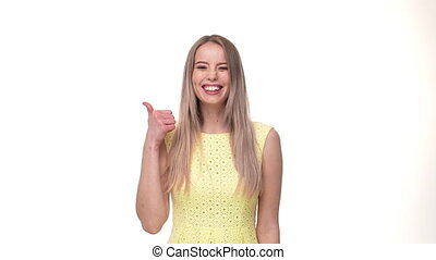 Young cheerful caucasian woman showing thumbs up over white background