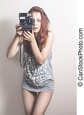 Young cheerful girl with a camera