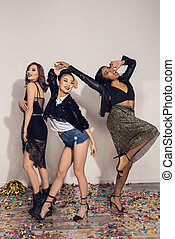 young cheerful multiethnic girls dancing at party indoors