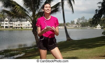 Young cheerful sportive female wearing shirt and shorts ...