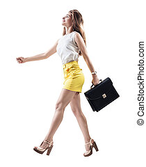 Young cheerful woman walking with briefcase.