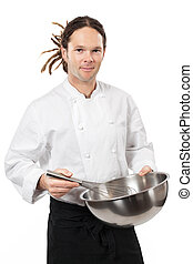 Young chef mixing with whisk