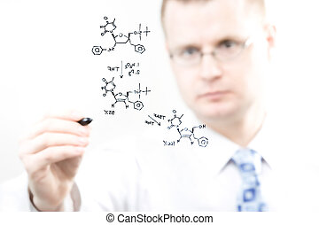 young chemist writing organic chemistry reaction equation, ...