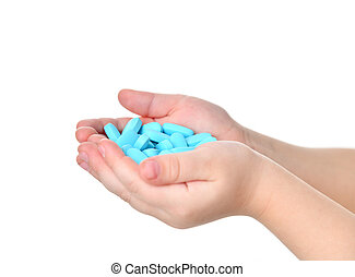Young child baby kid hands hold blue pain killer tablet of medicine