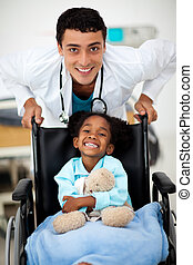 Young happy child being cared for by a doctor