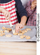 Young child decorating cookies