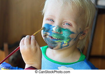 Young Child Getting His Face Painted - a one year old baby ...