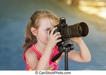 Young child girl photographer