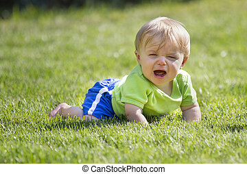 young child in grass