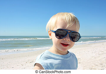 Young Child in Sunglasses on the Beach