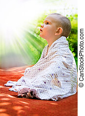 Young child looking in awe at the sun