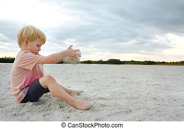 Young Child Playing in Sand at Beach