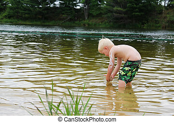 Young Child PLaying Outside in Lake