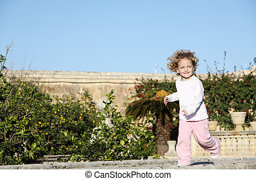 young child running
