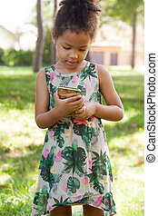 Young child using smartphone at park