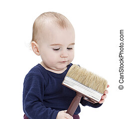 young child with brush