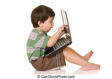 Young child, working on computer