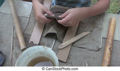 young child working with clay