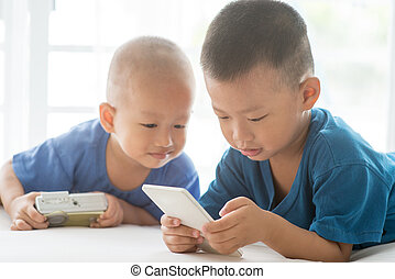 Young children addicted to smart phone.