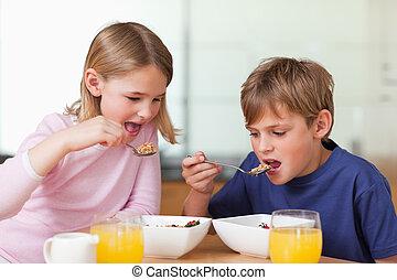 Young children having breakfast