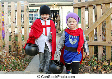Young Children Leaving House After Trick-or-Treating
