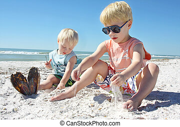 Young Children Playing in the Sand at the Beach