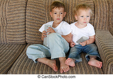 young children watching tv at home