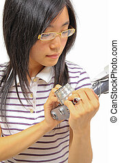 Young chinese woman holding a vintage camera