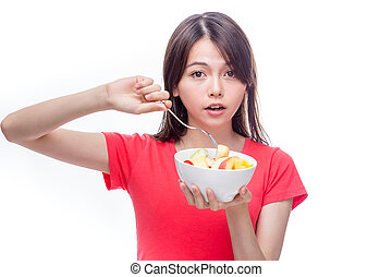 Chinese woman holding bowl of fruit