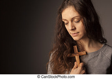 Young christian girl with cross
