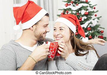 young christmas couple happy on sofa - young christmas ...
