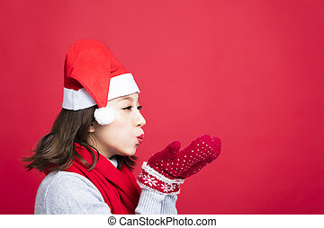 young Christmas woman Blowing the Snow