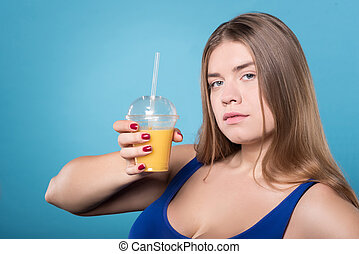 Young chubby lady holding juice