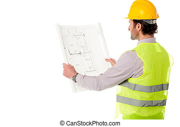 Young civil engineer at work - Rear view of a male...