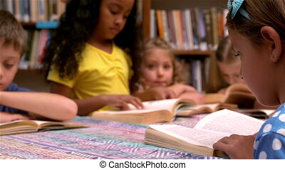 Young class reading books