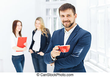 Young colleagues having coffee break in office