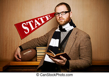 Young college man with books & ball - A young male college...