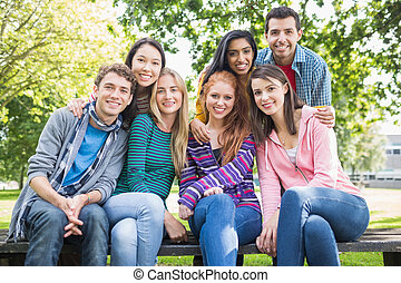 Young college students in the park - Group portrait of young...