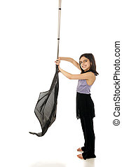 Young Color Guard Practicing - An elementary girl in her...