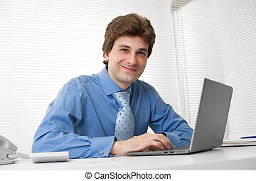 young confident business man with laptop