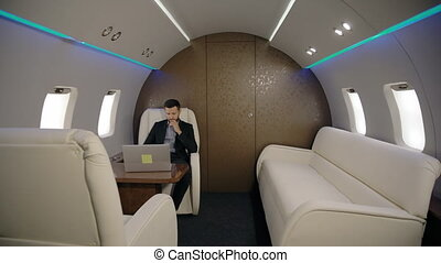 Young confident lawyer businessman is working with laptop...