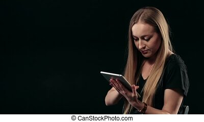 Young confident woman with the tablet pc isolated