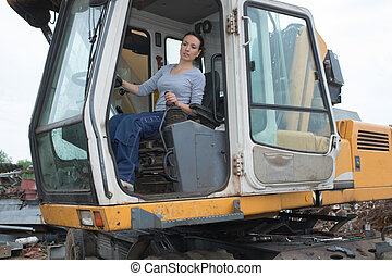 young construction female driver at work